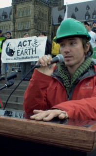 """Rob Stewart on Parliament Hill for """"Fill The Hill – C Day – International Climate Day in 2010 filming for the documentary film Revolution."""