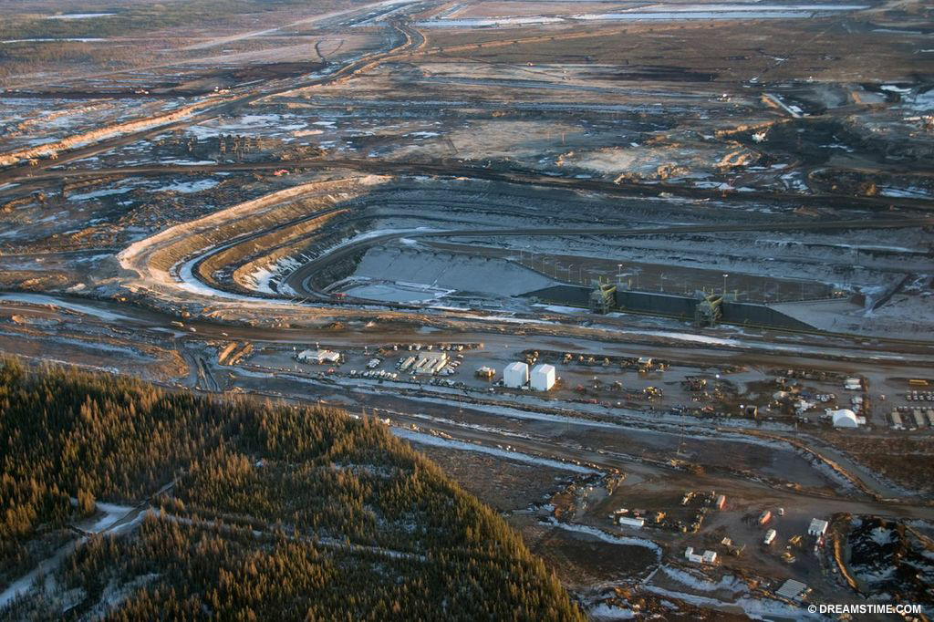 The tar sands lie under 140,000 square kilometres of northern Alberta. Oil sands are loose sand naturally soaked with a form of petroleum, or bitumen.